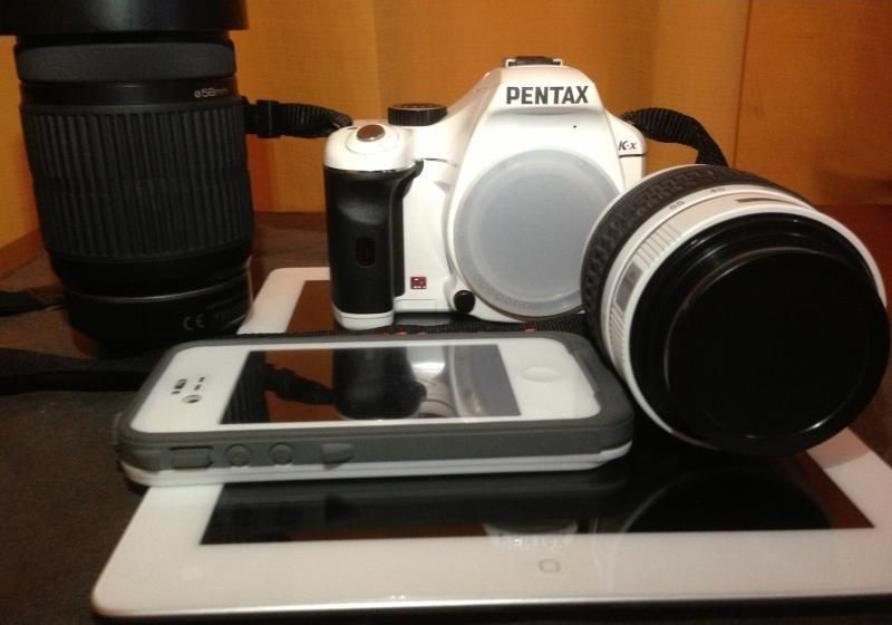 DSLR White Pentax KX w 18-55mm and 55-300mm Lens photo
