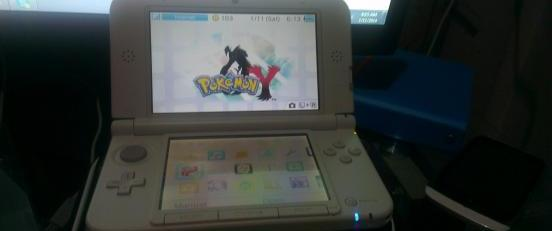 Nintendo 3DS XL WhitePink with Pokemon Y photo