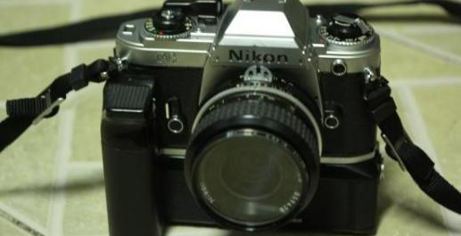 Nikon FG Manual Camera with 35 mm.2.8 lens and motordrive photo