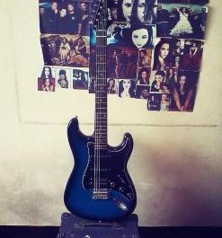 Electric guitar color blue and amplifier set photo
