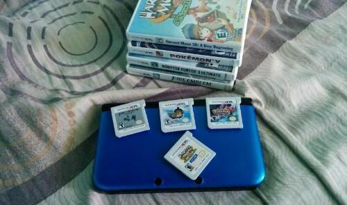 Nintendo 3ds Xl + 4 games Complete With Freebies photo