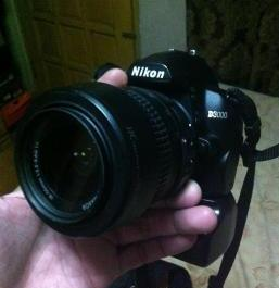 DSLR Nikon D3000 with nissin flash and battgrip photo