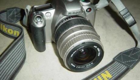 Nikon Us AF 35mm SLR Film Camera with 28-80mm Sigma MACRO Lens photo