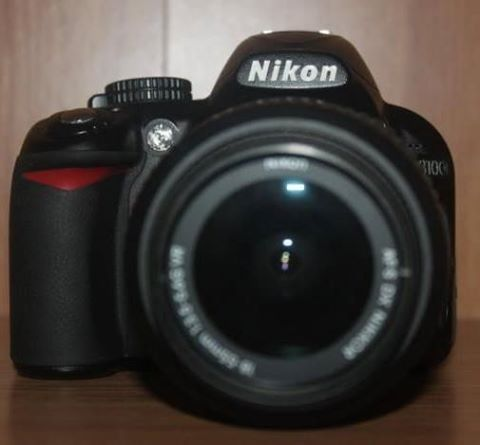 DSLR Nikon D3100 with lens and accessories photo