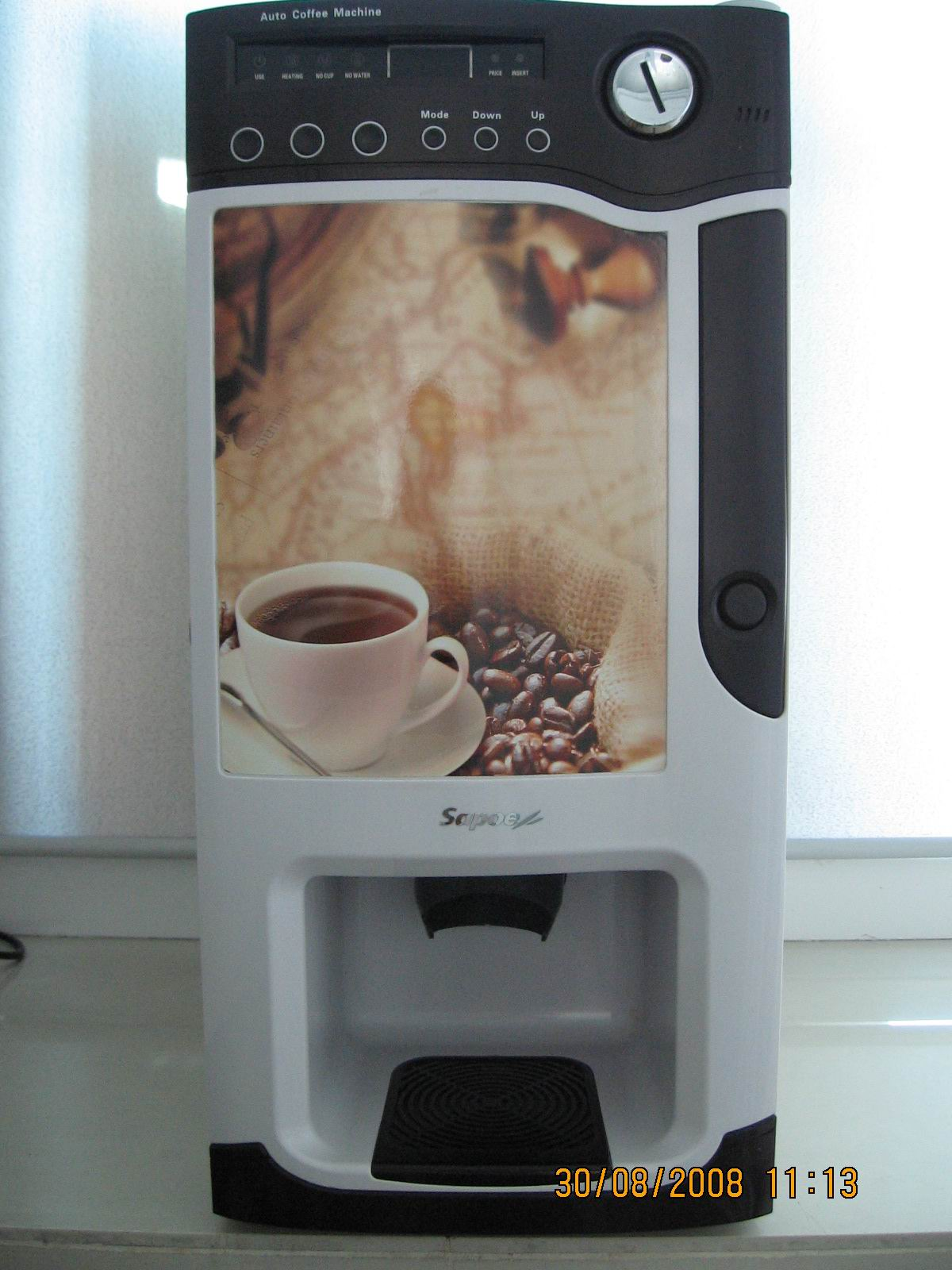 coffee vending machine with brace an LED lights photo