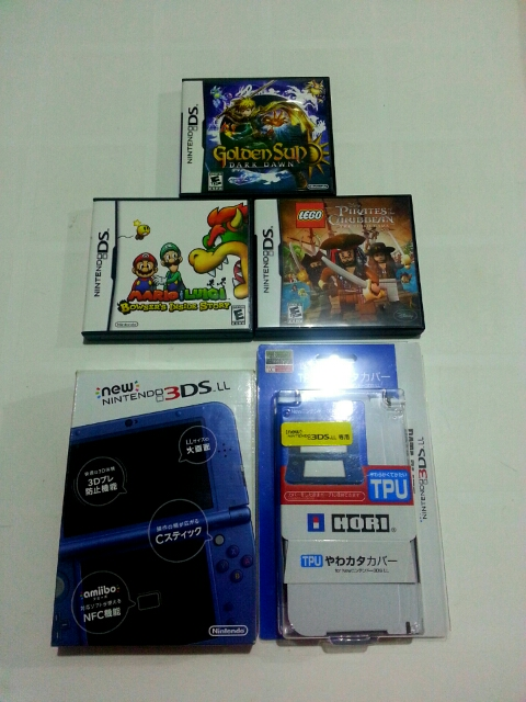 Nintendo 3DS XL + 3 DS Games + Adapter photo