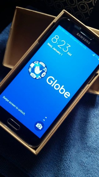 Samsung S5 Android 5.0 Lollipop Globe Locked photo