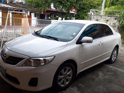 Toyota Altis For sale 2013 model white color, and first owner photo