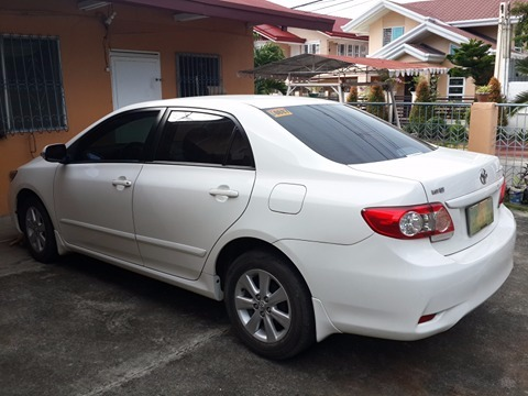 Toyota Altis For sale 2013 model white color, and first owner image 2