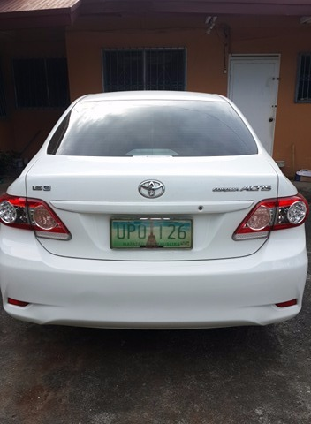 Toyota Altis For sale 2013 model white color, and first owner image 4
