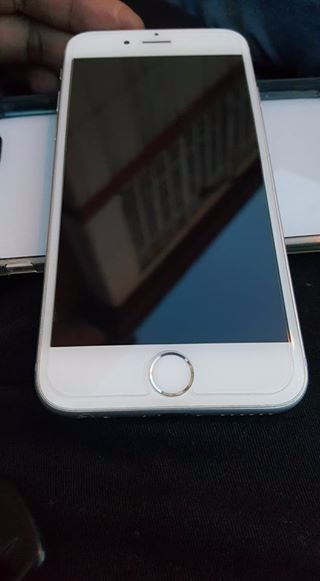 Iphone 6 16gb globe ( smooth as new ) photo