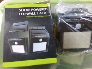 SOLAR POWERED LED WALL LIGHT WITH SENSOR FOR KENNEL USAGE photo