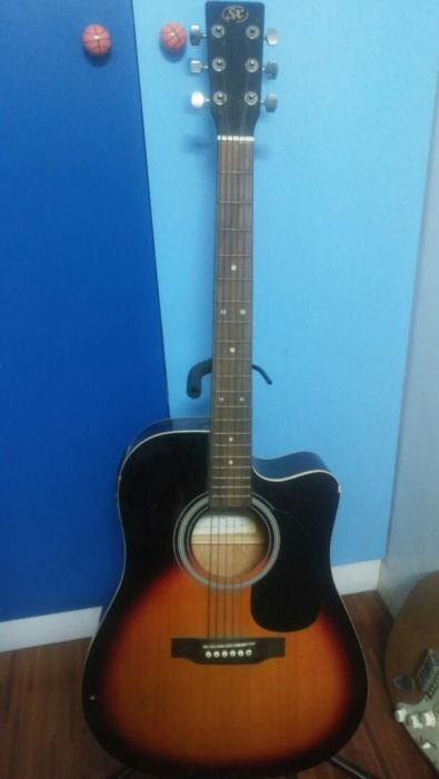 SX Acoustic Guitar photo